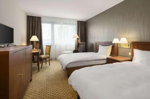 A room at Hotel Ramada Graz. Discover the best places to book your accommodation for Ironman 70.3 Graz, Austria in this complete article.