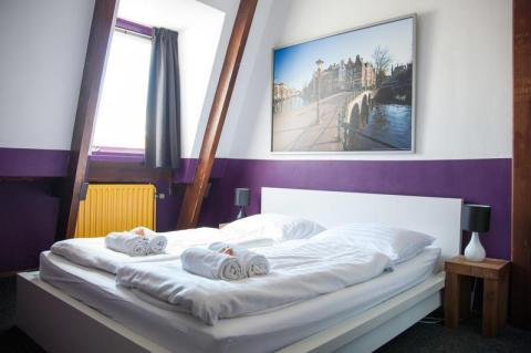 A room at Flying Pig Downtown Hostel. Planning a trip to Amsterdam? In this article we covered all the cost of accommodation, food and transport in Amsterdam for the perfect travel budget plan.