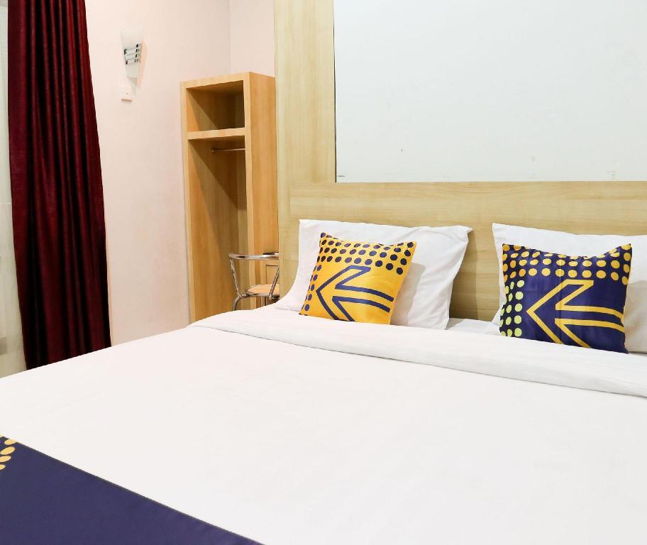 Fasilitas kamar SPOT ON 2182 Al-ghani 2