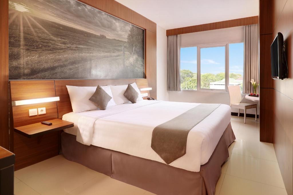 Kamar penginapan di Hotel Neo Palma - Palangkaraya by ASTON