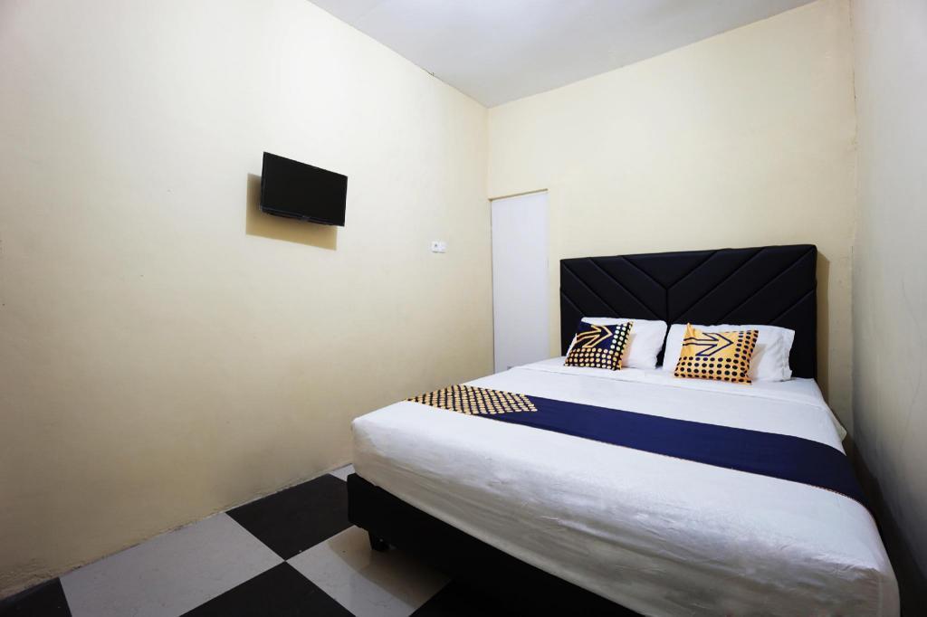 Kamar penginapan di Spot on 2530 Tiga Mas Inn
