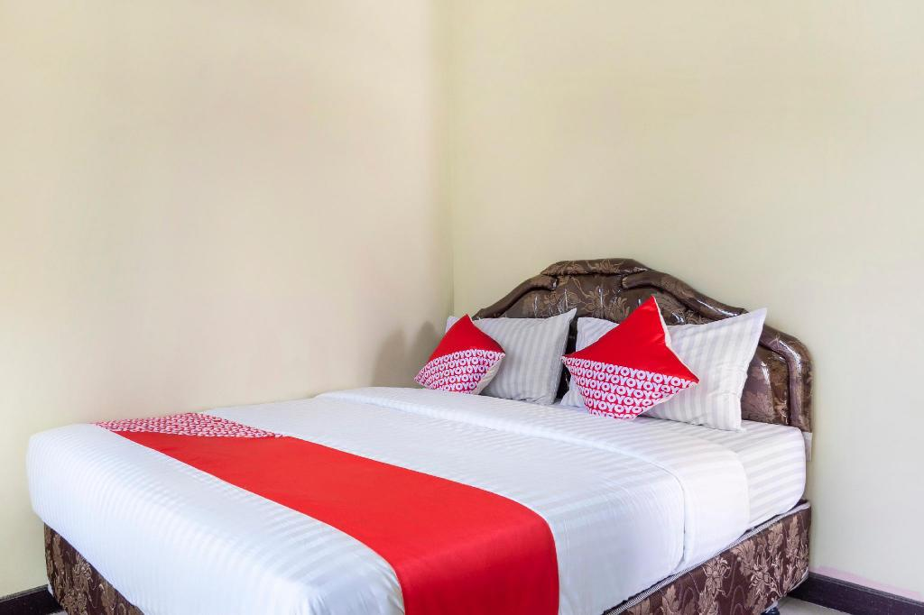 Kamar penginapan di OYO 2950 Grand Suites Palace