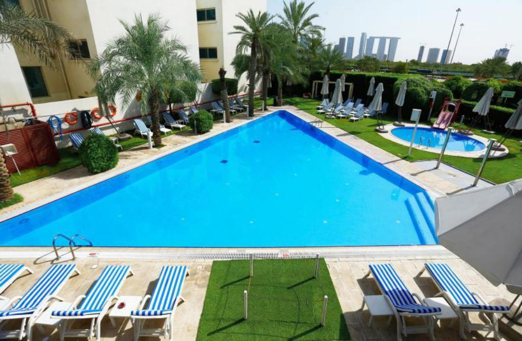 Best price on one to one hotel the village in abu dhabi - Hotels in abu dhabi with swimming pool ...