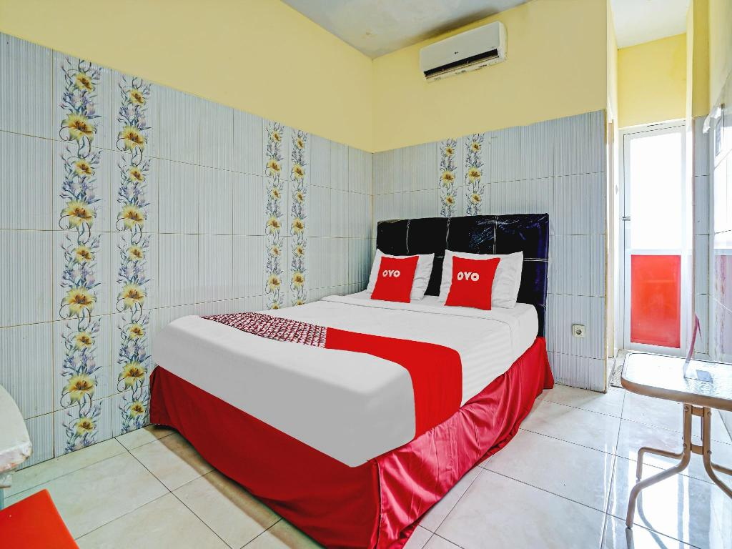 Kamar penginapan di OYO 90238 Hotel Nusantara