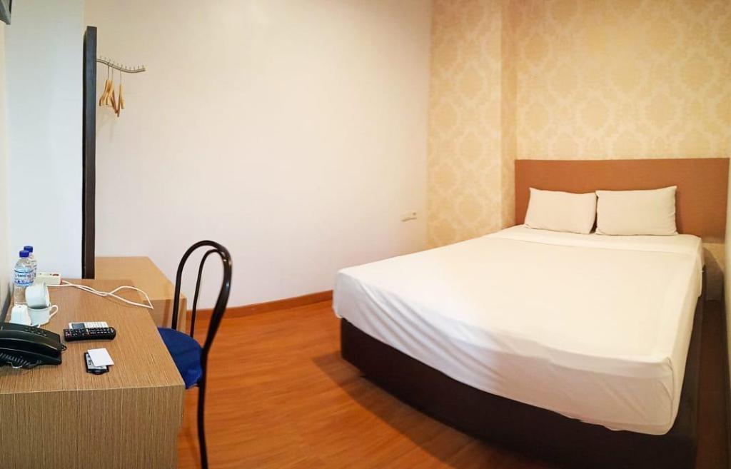 Kamar penginapan di Eljie Hotel