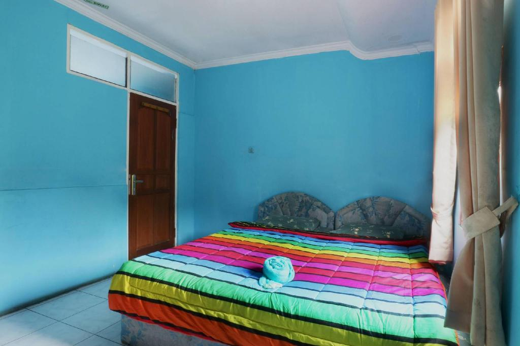 Kamar penginapan di Hotel Arjuna