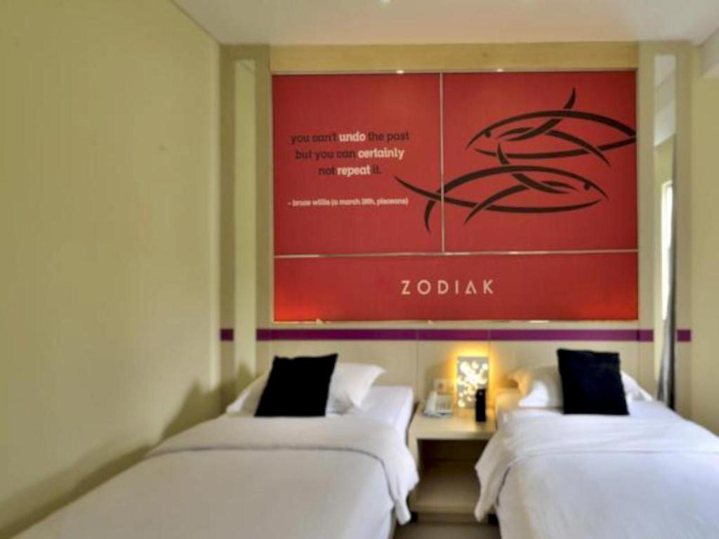 Fasilitas kamar Zodiak Hotel at Kebon Kawung
