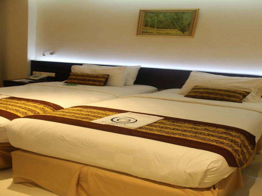 Kamar penginapan di G'Sign Hotel Banjarmasin