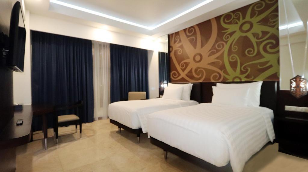 Kamar penginapan di M Bahalap Hotel Palangka Raya