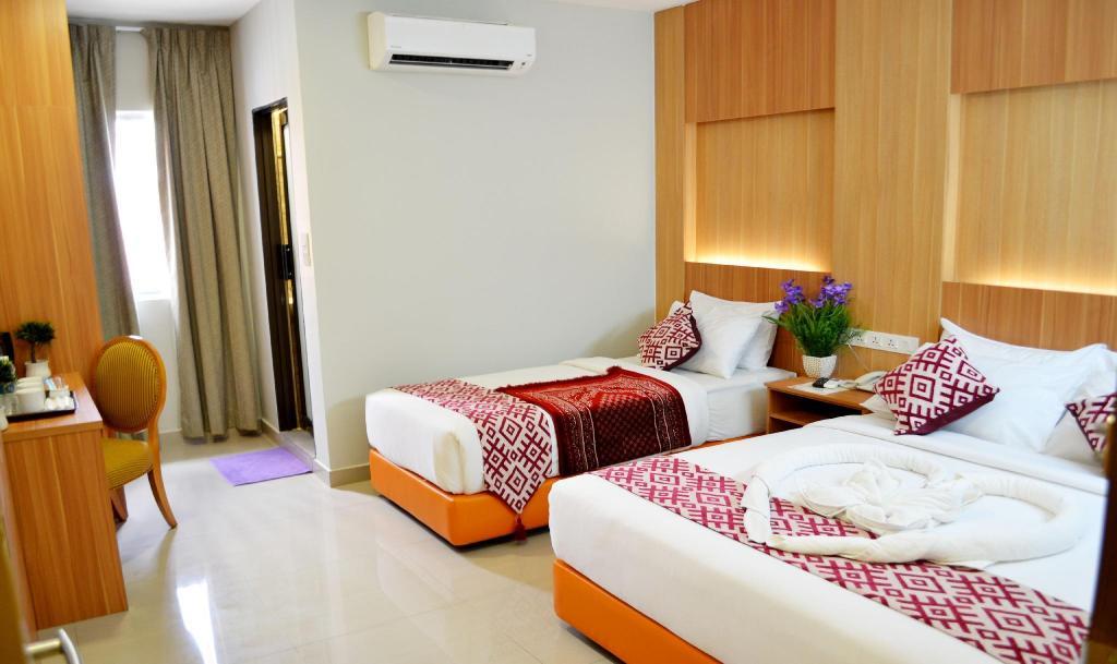 Deluxe Triple Room - Bedroom