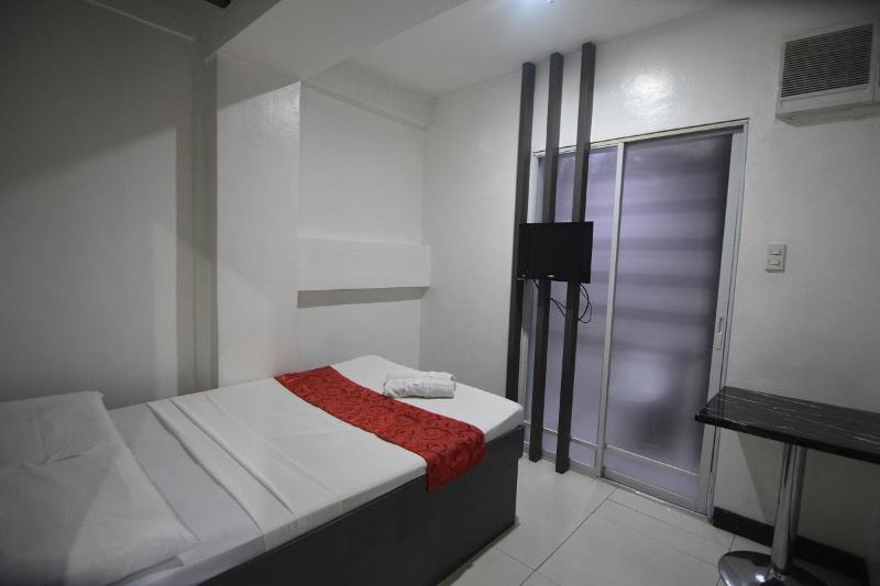 卡穆甯科斯莫飯店及套房公寓