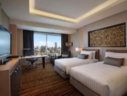 Executive-huone kahdella vuoteella ja aamiaisella