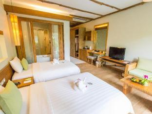 Metadee Resort and Villas Phuket - Hotellihuone