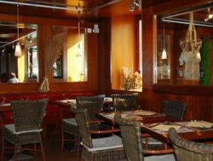 /galions-hotel-restaurant-et-pub/hotel/lausanne-ch.html?asq=5VS4rPxIcpCoBEKGzfKvtBRhyPmehrph%2bgkt1T159fjNrXDlbKdjXCz25qsfVmYT