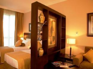 Al Manzel Hotel Apartments Abu Dhabi - Guest Room