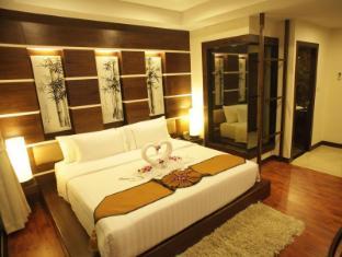 Bamboo House Phuket Hotel Пхукет - Вітальня