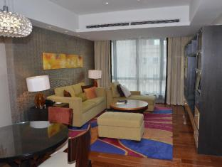 The Sandalwood Beijing Marriott Executive Apartments Beijing - One bedroom living room towards South