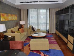 The Sandalwood Beijing Marriott Executive Apartments Beijing - One bedroom living room toward South