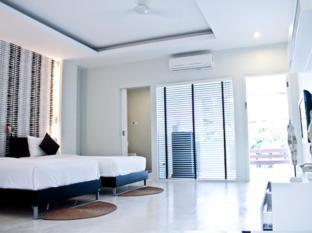 Surintra Resort Phuket - Kamar Tidur
