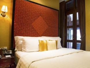 Nostalgia Hotel Singapur - Külalistetuba