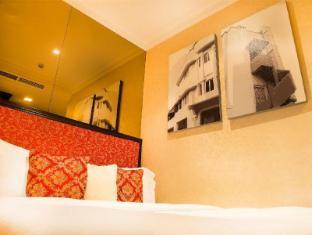 Nostalgia Hotel Singapore - Gæsteværelse
