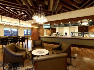 Marriott Hotel Manila Manila - is   Grab a cup of any of Cremas premium coffee creations or Felchins hot chocolate and pair with its local signature, the macapuno egg tart