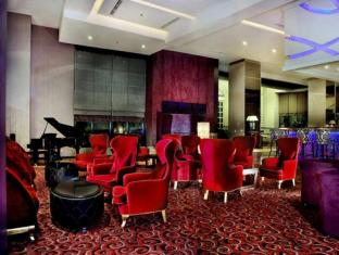 Grand Aston City Hall Hotel & Serviced Residences Medan - रेस्त्रां