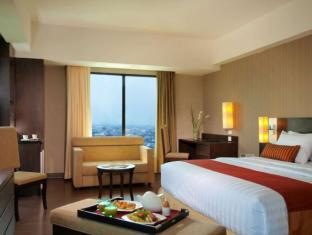 Grand Aston City Hall Hotel & Serviced Residences Medan - Chambre