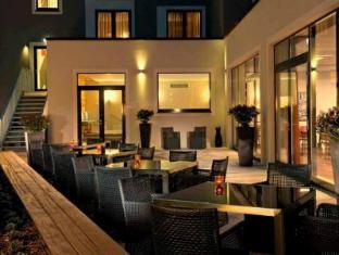 아디나 아파트먼트 호텔 베를린 하프트바노프 베를린 - 식당