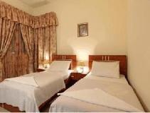 Palmland Hotel Suites: guest room