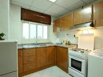 Palmland Hotel Suites: kitchen