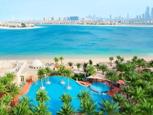 Kempinski Hotel & Residences Palm Jumeirah Dubai - Pool Beach & Gardens and Dubai Skyline
