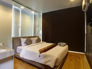 The Belle Resort Phuket - Quartos