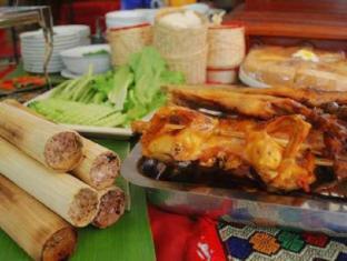 Win Hotel Vientiane - Eten en drinken