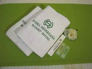 Wisma Sederhana Budget Hotel Medana - Vannas istaba