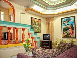 Capt. Hook's Red Parrot Inn Davao - Chambre