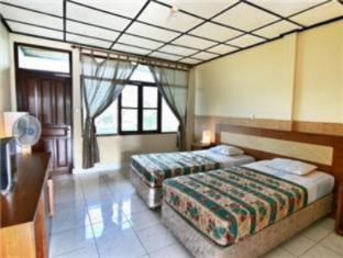 Villa Puri Royan Bali - Külalistetuba