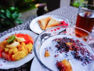 戴薩科普圖普特拉普特拉民宿飯店 峇里島 - 餐飲服務