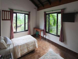 Hotel Parkside Chitwan - Kamar Tidur