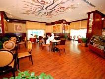 Al Bustan Tower Hotel Suites: coffee shop/cafe