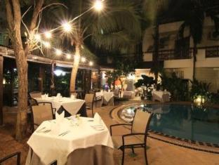 Sugar Home Serviced Apartment Pattaya - Restaurant by the pool