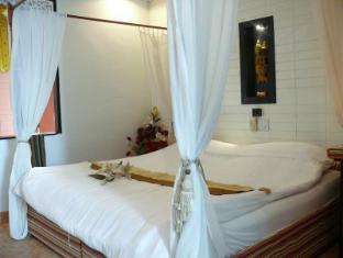 Hollanda Montri Guesthouse Chiang Mai - Pokój gościnny