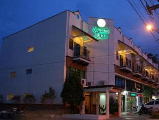 Ecoland Suites Davao - Hotellet udefra