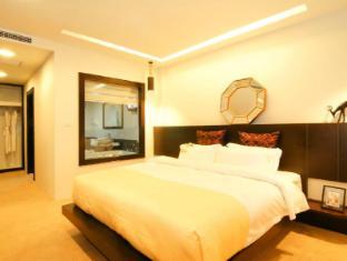 Rashmi's Plaza Hotel Vientiane Vientiane - Executive Suite Bedroom