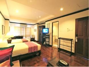 Cucumber Inn Suites and Restaurant Pattaya - Deluxe Twin Suite Room