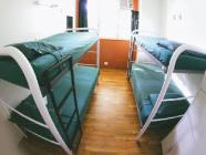 Single bed in Co-ed Dormitory room