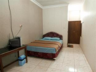 Orchid Guest House Surabaya - Guest Room