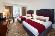 חדר דלוקס עם שתי מיטות יחיד ונוף לעיר
