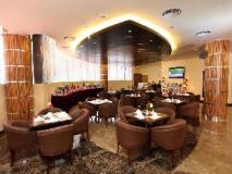 Xclusive Maples Hotel Apartment: coffee shop/cafe