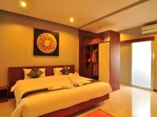 Phu NaNa Boutique Hotel Phuket - Külalistetuba